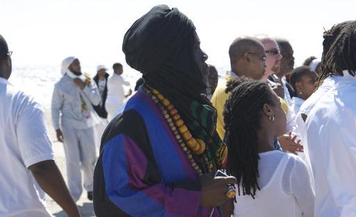 Jamaican reggae-poet Mutabaruka [with black turban]