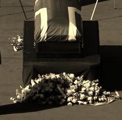 Coffin on tarmac
