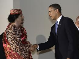 Obama shaking hands with Muammar Ghadaffi - here today and gone tomorrow