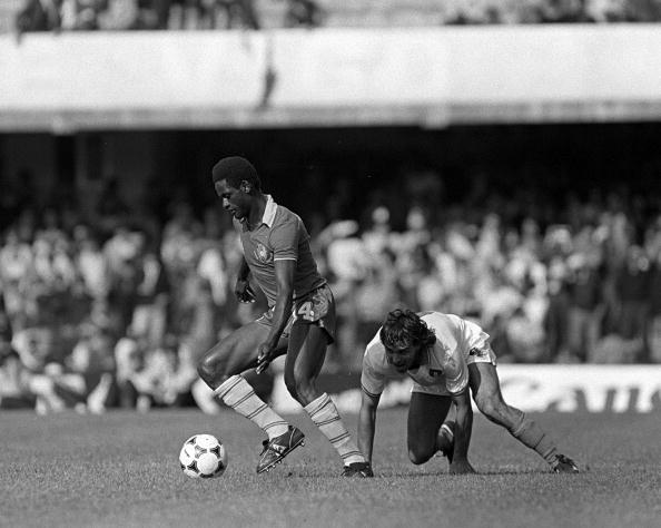 1982 World Cup Finals, Vigo, Spain, 23rd June 1982, Italy 1 v Cameroon 1, Italy's Antonio Cabrini is left grounded by Cameroon's Theophile Abega during their Group A match (Photo by Bob Thomas-Getty Images)