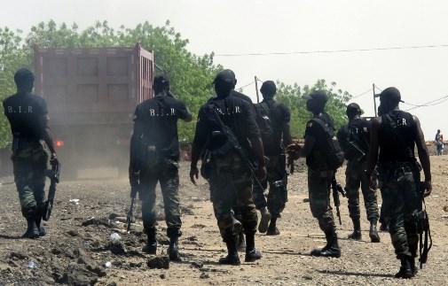 Men of the rapid intervention battalion (BIR) patrol on in Waza, northern Cameroon. (Reinnier Kaze-Agence France)
