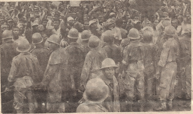Troops holding back demonstrators at SDF launch May 26, 1990