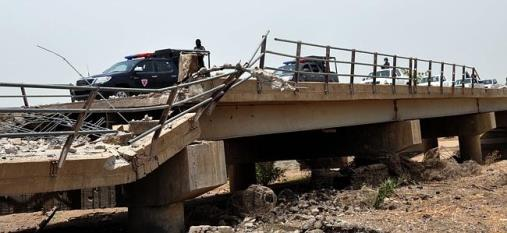 A bridge connecting Nigeria and Cameroon destroyed by Boko Haram insurgents in May 2014 (c) AFP